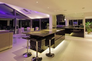 This black glass ALNO kitchen comes into its own at night.