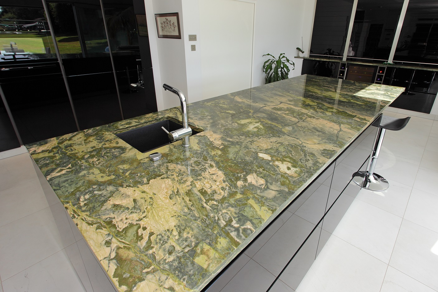 Specially imported, Brazilian green bamboo granite helps link the kitchen with the garden in the James' beautiful Hampshire home.