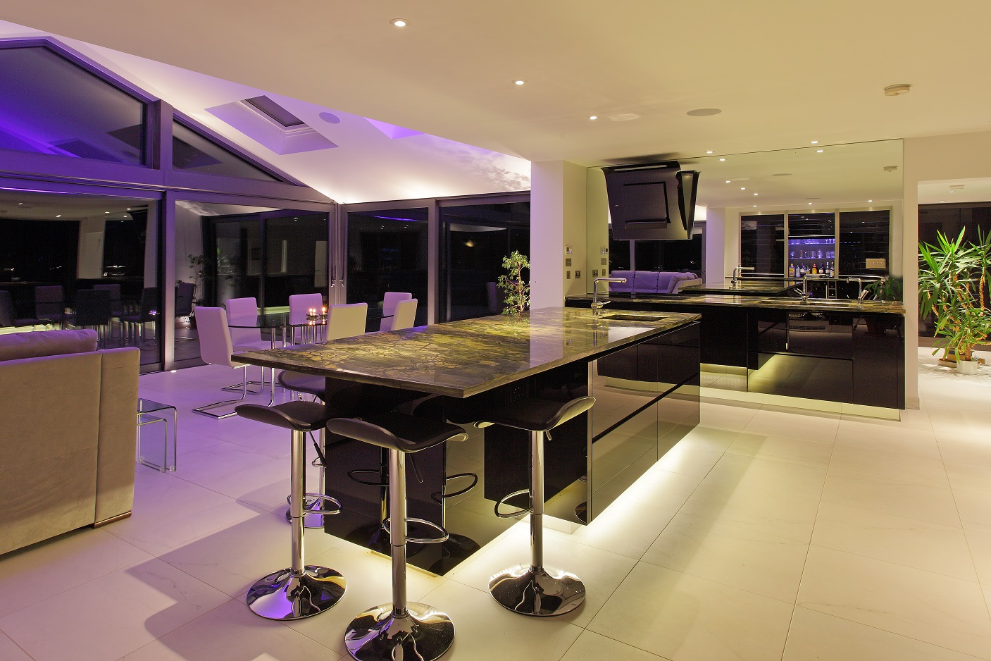 The true glory of the kitchen lighting scheme comes out at night.