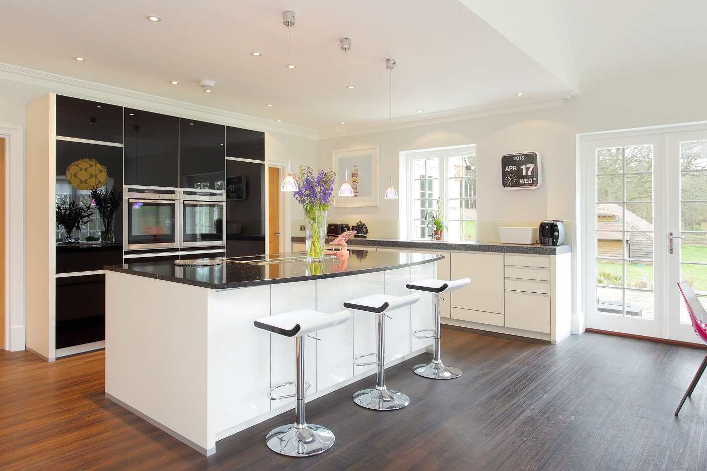 hampshire kitchens has installed this fabulous high gloss black and magnolia kitchen plus matching utility room in a 1930s home just outside farnham - Family Kitchen